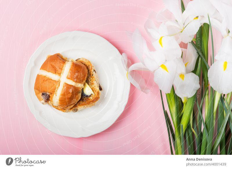 Easter Breakfast with Hot Cross Buns hot cross bun easter bread butter food traditional sweet flower iris fresh white holiday wooden celebration cake baked