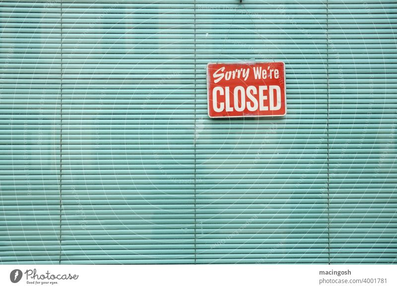 Shop window with green blind and CLOSED sign lockdown closing time closing hours Green Venetian blinds Store premises Gastronomy Sorry we're closed Signage