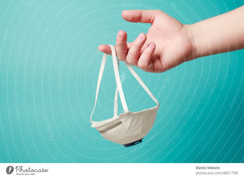Hand iholding mask sharing protective respirator. N95, FFP2, COVID-19, 2019-nCoV, virus protection, dust respirator concept. care breathing disease epidemic flu