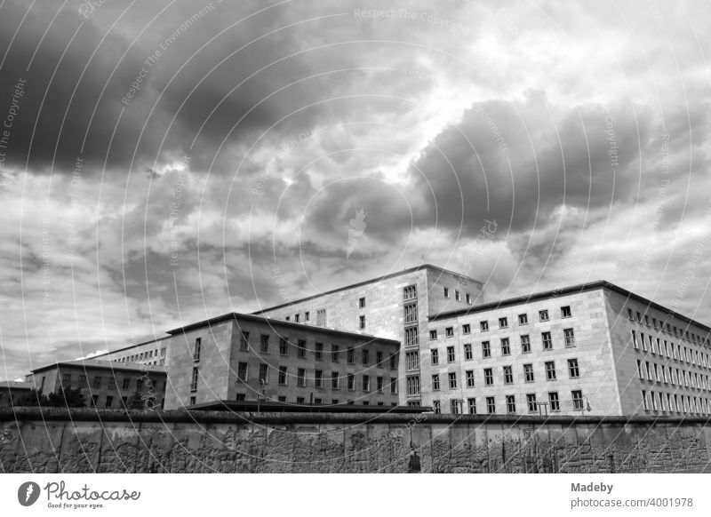 View over the Berlin Wall in Niederkirchnerstraße to the building of the Federal Ministry of Finance in Wilhelmstraße in the Mitte district of the capital Berlin, photographed in classic black and white