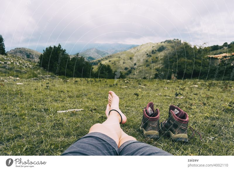 bare feet resting after climbing a mountain horizontal toe peaceful recovery relaxing solitude tranquility copy-space naked serene skin well wellbeing foot