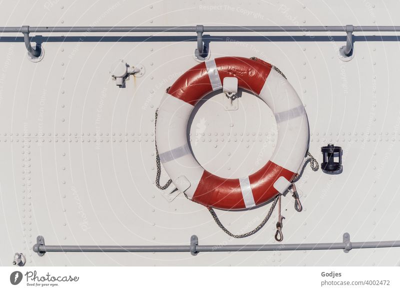 Lifebelt on metal white ship's side Life belt Rescue Navigation Colour photo Exterior shot Deserted Safety Water Ocean Day Watercraft Red Boating trip Blue
