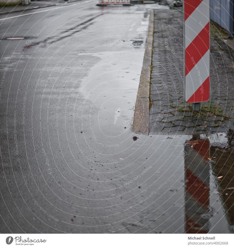 Attention: Bad weather! Rain Water Wet Weather Street Road sign esteem Construction site Exterior shot Deserted Road traffic Town Signage Warning sign
