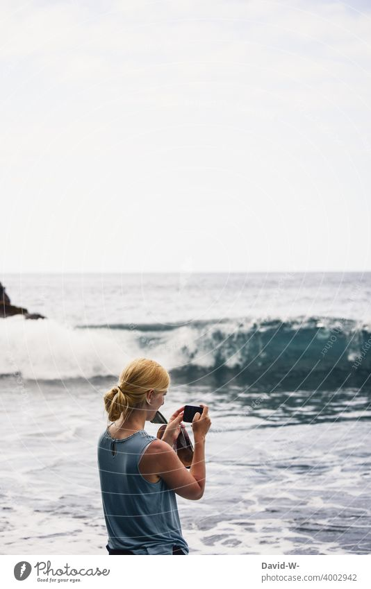 Holiday photo - woman photographing the sea vacation Take a photo souvenir Memory Cellphone Ocean Vacation photo Vacation good wishes Woman camera
