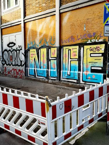 Construction site with a wall with graffiti Scaffolding Facade Redecorate Modernization Graffiti Structures and shapes Letters (alphabet) Redevelop Street art