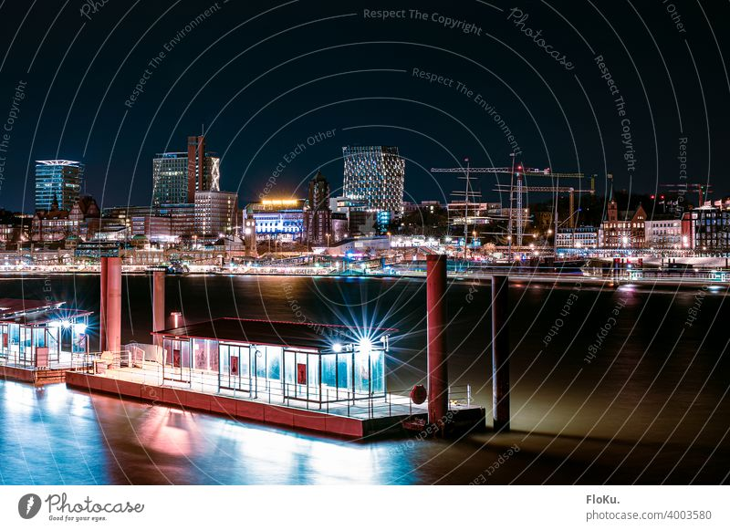 View of the St. Pauli Landungsbrücken at night Hamburg Harbour Watercraft Elbe River Navigation Port of Hamburg Port City Economy Town Blue Transport Night