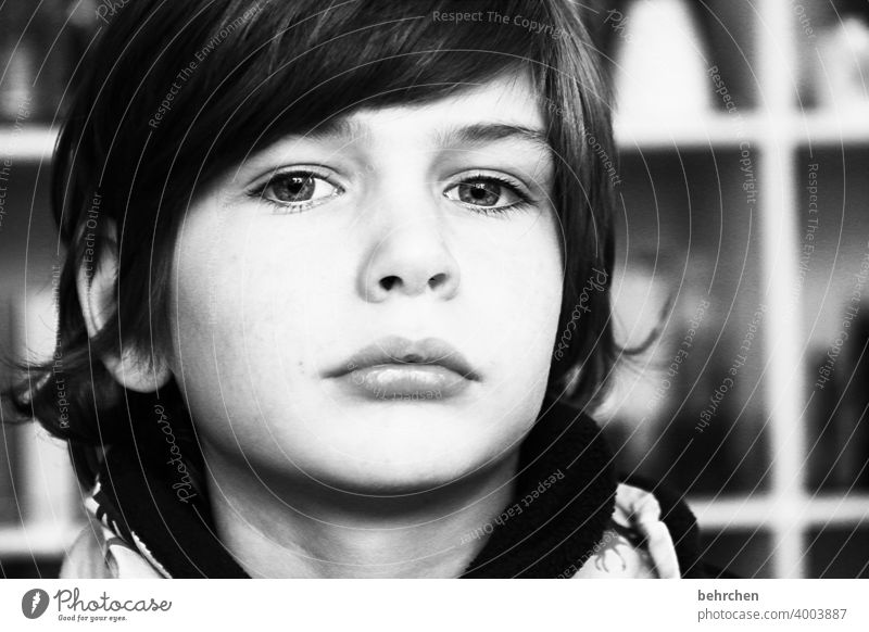 . Black & white photo Intensive Family & Relations Emotions Close-up portrait Boy (child) Light Son Child Sunlight Contrast Day Face Infancy Earnest long hairs