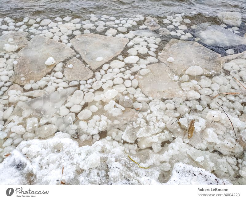 large and small ice floes on a lake Frozen Lake Ocean Frost Slice Ice Plaice quick-frozen ice crystals background icily Abstract Winter Snow Water Season