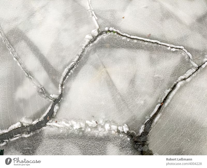 Close-up of ice floes on a lake, at freezing temperatures Frozen Lake Ocean Frost Slice Ice Plaice quick-frozen ice crystals background icily Abstract Winter