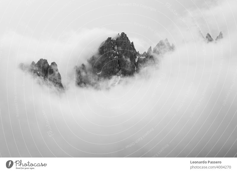 "the mountains dolomites ""rocca dei baranci"" covered by clouds , San Candido - Italy Dolomites dolomiti dolomitic Mountain Mountain ridge italy Veneto alto adige"