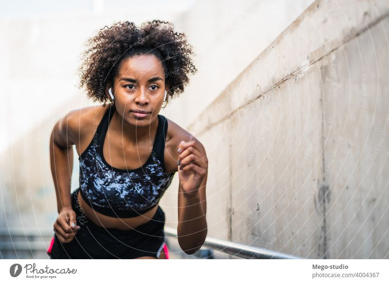 Afro athlete woman running outdoors. sport exercise training runner background people care leisure body portrait sports action motion cardio exercising
