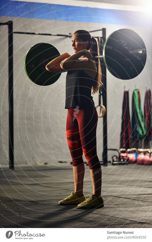Caucasian woman lifting a barbell. crossfit functional training gym health sport fitness workout exercise lifestyle healthy adult vitality sportswear gymnastics