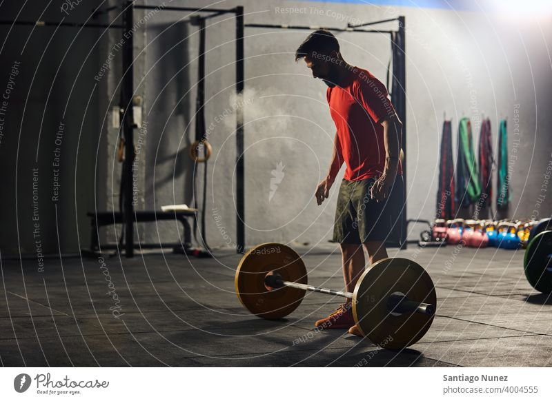 Caucasian man lifting a barbell. crossfit functional training gym health sport fitness workout exercise lifestyle healthy adult vitality sportswear gymnastics