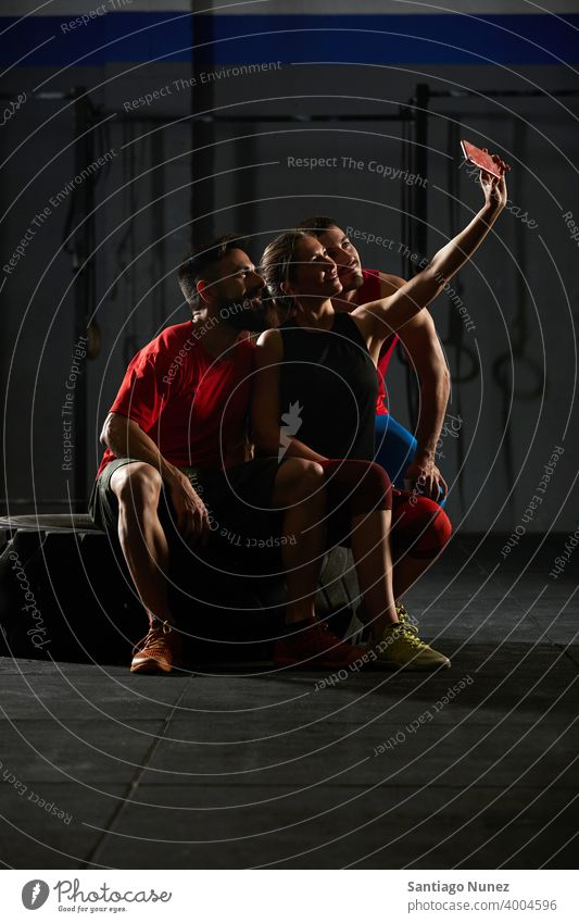 People taking a selfie in a gym. crossfit functional training health sport lifestyle healthy adult sportswear gymnastics equipment room sporty athletic muscle
