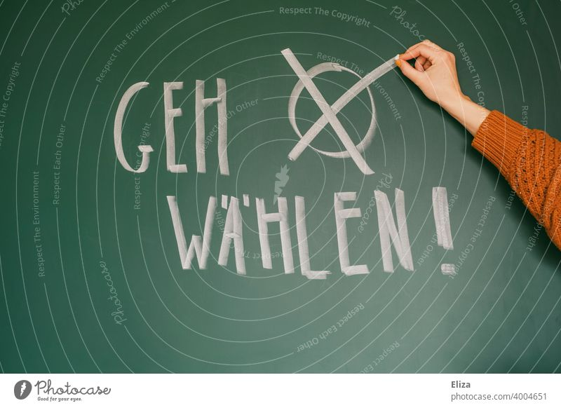 """Prompt """"Go vote!"""" written on a blackboard. Hand makes a cross. Federal elections. Elections Select Democracy Crucifix Vote German federal elections policy"""