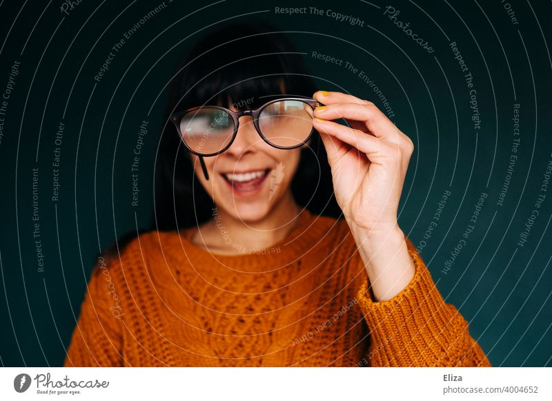 Woman looking through glasses while laughing Eyeglasses Laughter Funny foolish see hazy Enlarged Qautsch Grimace Face Eyes Joy
