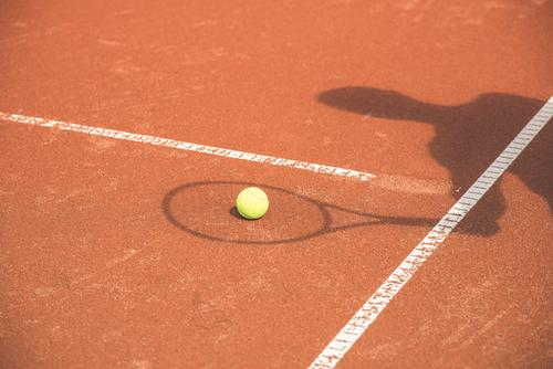 Shadow plays tennis Tennis Sports creatively Tennis court Leisure and hobbies Playing Tennis ball Sportsperson Sporting event