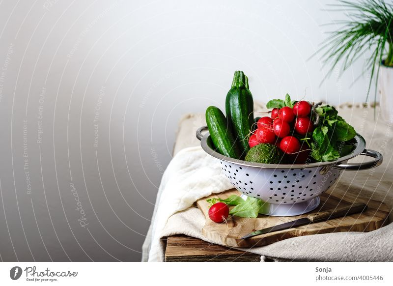 Raw radishes and green vegetables in a colander on a kitchen table Vegetable Green Radish Still Life Kitchen Table Rural Vegetarian diet Healthy Eating