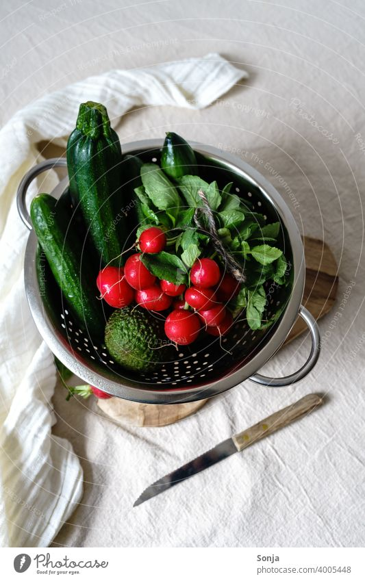 Radishes and green vegetables in a colander on a beige linen tablecloth Vegetable Green Raw Sieve Linen Healthy Food Vegetarian diet Organic Fresh Diet Rural