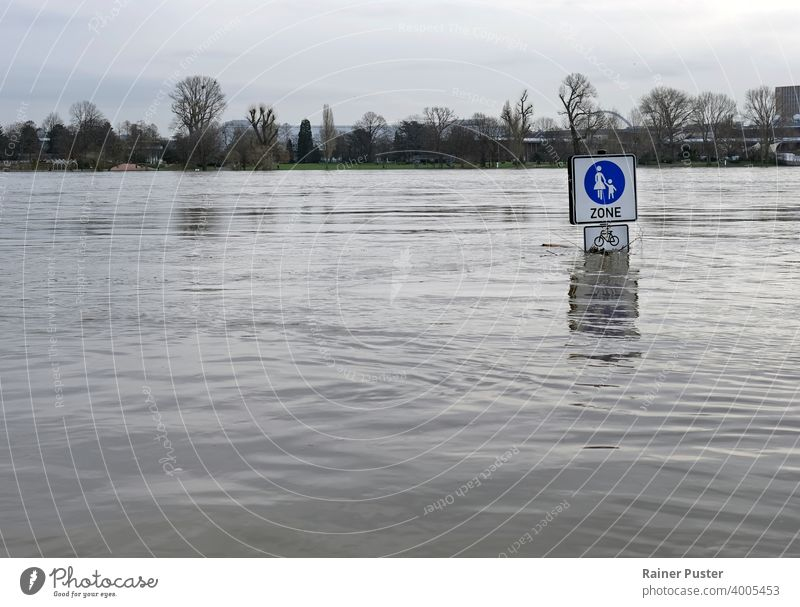 Extreme weather: Street signs in a flooded pedestrian zone in Cologne, Germany climate climate change cologne disaster extreme weather flooded street germany