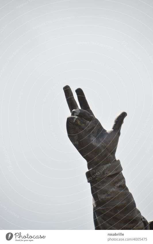 Hand of a statue points to the sky | Contemporary History Sign language gesture Gesture Communicate Direction Forefinger Fingers portion arm open space