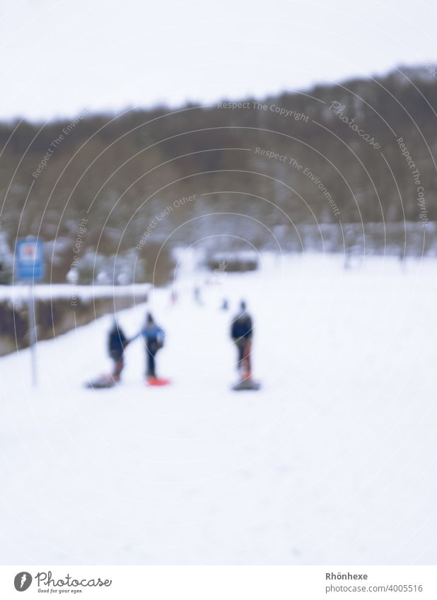 Children in village sledding blurred photo children sledging Sleigh Winter Snow Cold Nature White Sledding Joy Colour photo Exterior shot Leisure and hobbies