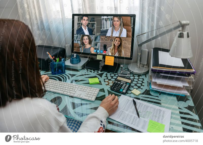 Woman on video conference work meeting unrecognizable woman teleworking covid-19 quarantine coworkers coronavirus computer telecommuting working from home
