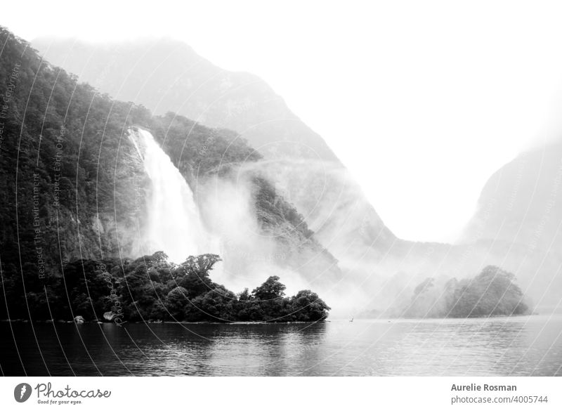 Milford Sound waterfalls, New Zealand background fog misty Waterfall Black & white photo landscape nature famous place loch valley montains