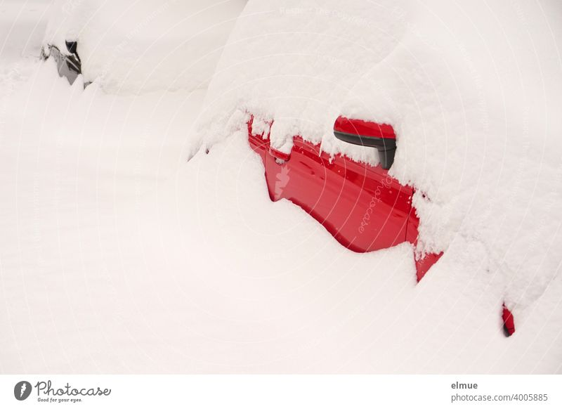 Masses of snow are lying on a red and a black car, so that only little of them can be seen / snowed in / onset of winter / fresh snow Snow Snow masses