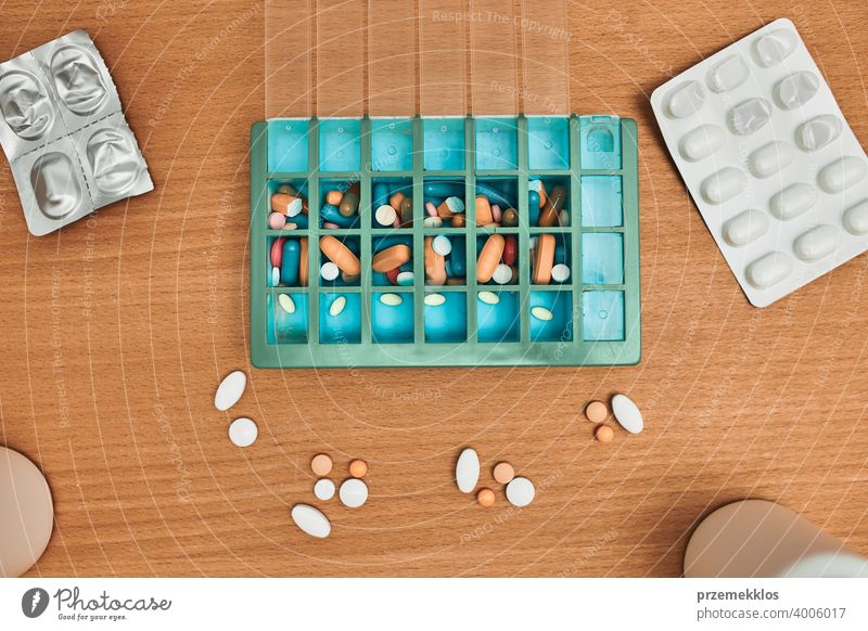 Pill dispenser. Healthcare and old age concept with medicines pill senior medication disease patient prescription medical person pharmaceutical routine weekly