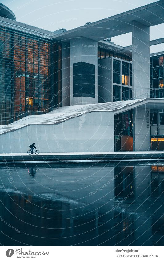 Marie-Elisabeth-Lüders-Haus with cyclist with ice floes V Reichstag tranquillity lockdown Culture Art Downtown Berlin Congress building Manmade structures