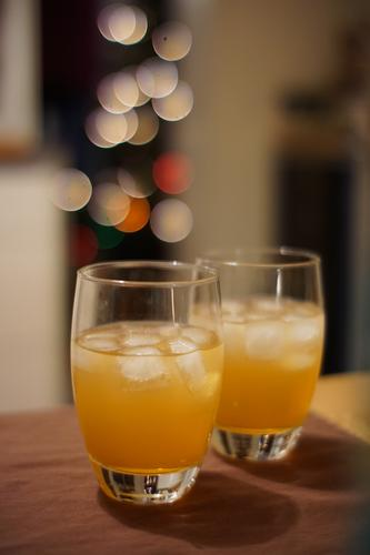 Drinks with ice and lights bokeh drink Ice Ice cube Beverage Alcoholic drinks Glasses Toast Orange Bitter herbs Christmas Festive Glamor glitter focus gradient