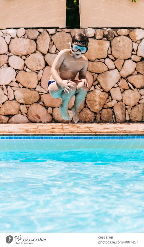 Little child jumping into a pool active activity adorable blue boy bright cheerful childhood cute energetic fun girl glasses handsome happiness happy healthy