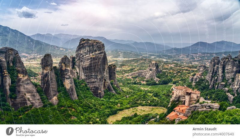 Rock formation and monastery in the mountain landscape of Meteora, Greece abbey architecture attraction beautiful building christian christianity church cliff