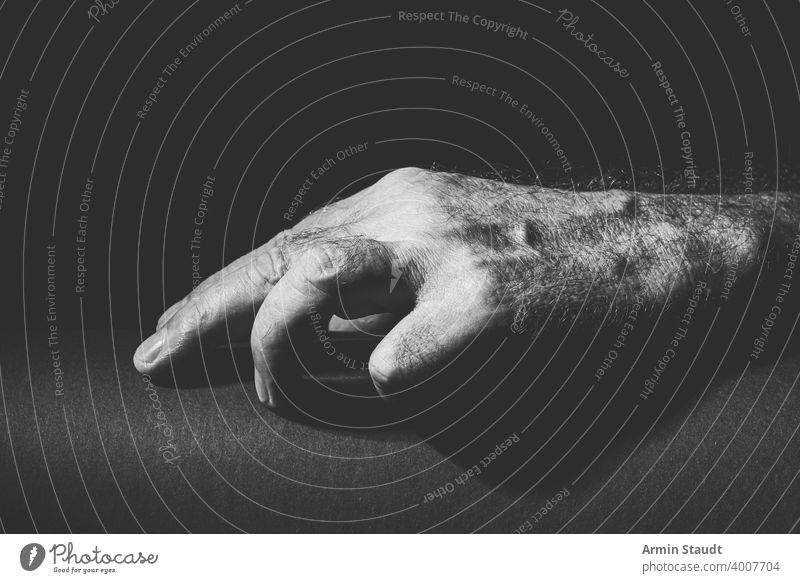 black white recording of a relaxed hand absently adult black and white bright bw calm closeup communication contrast dark expression finger gesture hear human