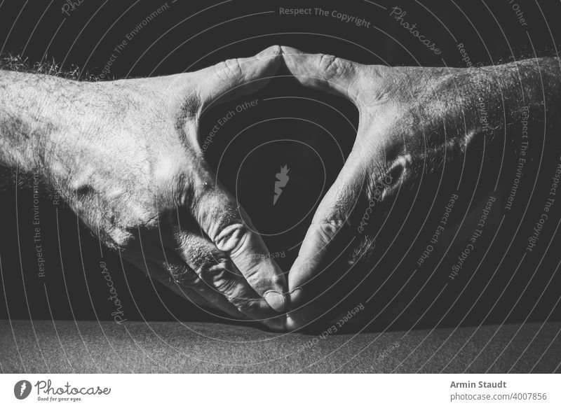 close-up of two hands showing the famous Merkel diamond adult angela black black and white bright business bw closeup contrast dark expression finger gesture