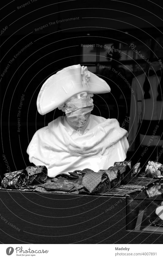 Bust of Frederick the Great with mouth guard in front of the shop of a men's outfitter in the Hackesche Höfe at Hackescher Markt in the capital Berlin, photographed in neo-realistic black and white