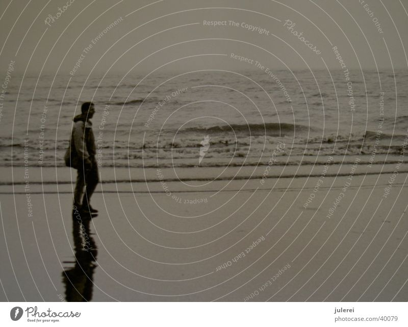 mudflat walker Ocean Man Waves Reflection Black & white photo old photo Water