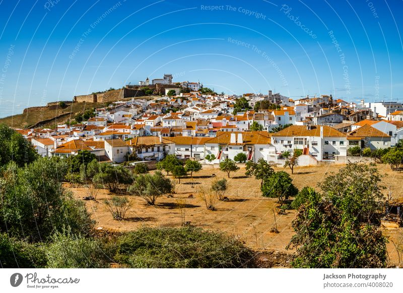 Cityscape of historic town of Estremoz, Alentejo. Portugal alentejo estremoz cityscape portugal village green copy space blue sky medieval wall houses