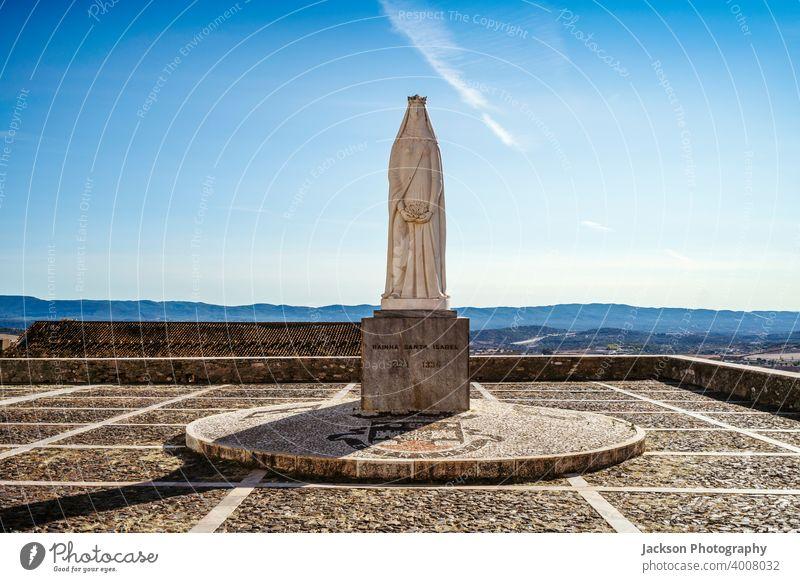 Monument of queen Saint Isabel in Estremoz, Portugal estremoz isabel saint castle copy space sky blue outdoor mountains art church monument isabela santa