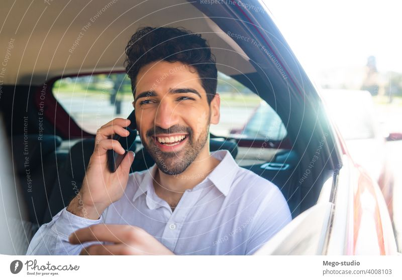 Businessman talking on phone in car. businessman mobile taxi transportation cab male portrait adult professional auto going to work wireless entrepreneur