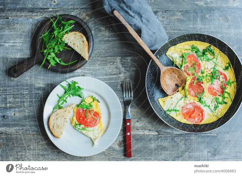Tasty Italian Style Vegetarian Breakfast Fried Eggs Frittata Ot Omelete With Mozarella Cheese Arugula And Tomatoes A Royalty Free Stock Photo From Photocase