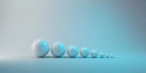 3d rendering. simple white small to big sphere ball object on gray background. growing up or evolution concept. grey group three three-dimensional level play