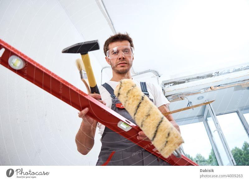 Builder man with construction tools. Repair concept renovation repair instrument equipment handyman protection builder male worker protective people craftsman