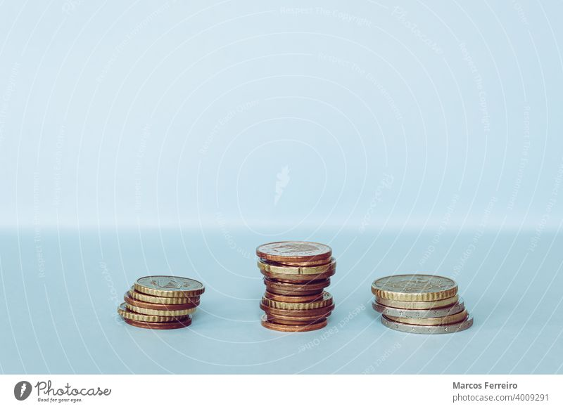 Euro coins are stacked, blue background counting paying salary exchange payday earning economics european metal concept commerce finance money business currency