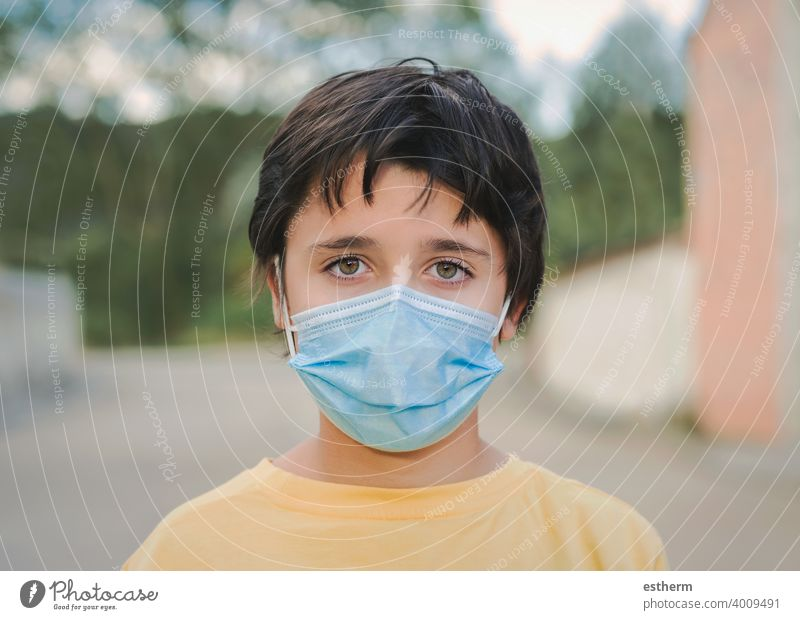 Close-up of kid wearing protective surgical mask coronavirus medical mask covid epidemic pandemic quarantine child covid-19 2019-ncov covid 19 symptom medicine
