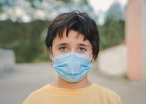 Close-up of kid wearing protective surgical mask coronavirus medical mask covid epidemic pandemic quarantine child covid-19 2019-ncov covid 19 symptom medicine