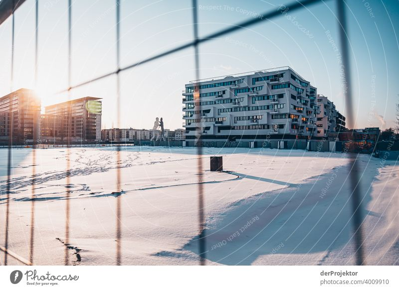 Molecule Man in winter with new building Wall (barrier) Wall (building) Hip & trendy Light Day Copy Space middle Exterior shot Experimental Copy Space top