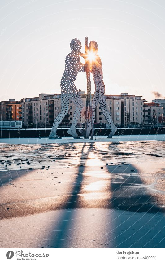 Molecule Man in Winter with Spree Wall (barrier) Wall (building) Hip & trendy Light Day Copy Space middle Exterior shot Experimental Copy Space top Berlin