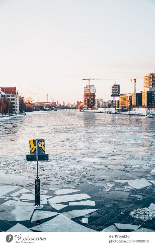 Sunset with floes and graffito in winter with Spree river Wall (barrier) Wall (building) Hip & trendy Light Day Copy Space middle Exterior shot Experimental